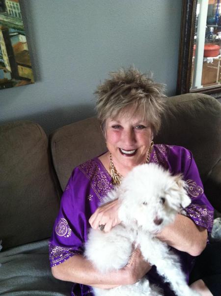 Beautiful Kathy with the family dog.  Kathy's hubby Roy loves how Savannah styles Kathy's hair
