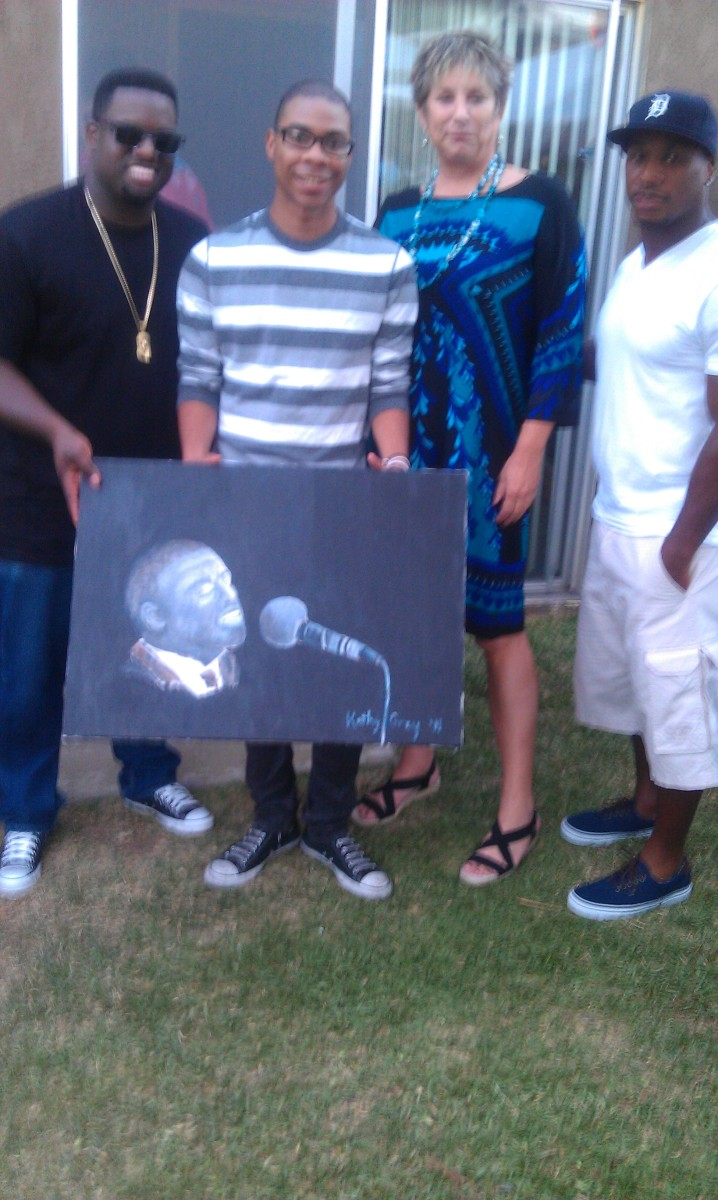 """Mary Mary/Kanye West/Alicia Keys/Luther/Stevie Wonder/Kelly Price Producer Warryn """"Baby Dubb"""" Campbell (first on the left) and cousin Roy Gray Jr. (second, left) hold up the marvelous Warryn Campbell birthday gift portrait painted by the gifted Kathy Gray, wife of Jazz Joy and Roy's Roy, who proudly stands next to still another member of the talented family, Famed New Orleans Saints running back Darren Sproles, formerly of the San Diego Chargers (fourth on the right)."""